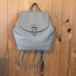Gray backpack with long adjustable straps